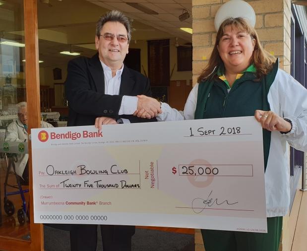 Dennis Tarrant from Murrumbeena Community Bendigo Bank with Club President Mary-Anne Saffigna.
